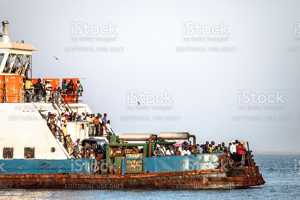 Small ferry full of people. stock photo