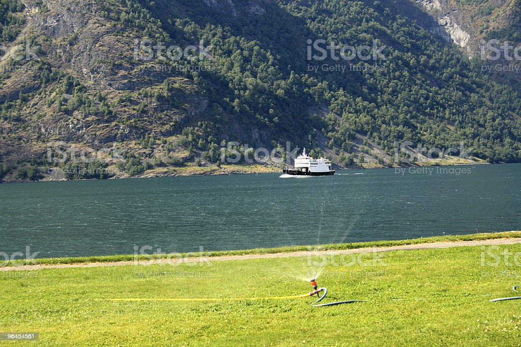 Small Ferry in Norwegian Fjord royalty-free stock photo