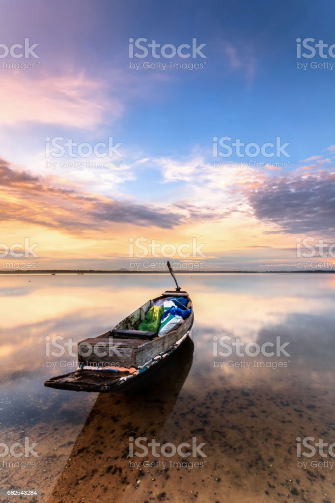 small fishing boat at lake with sunset stock photo