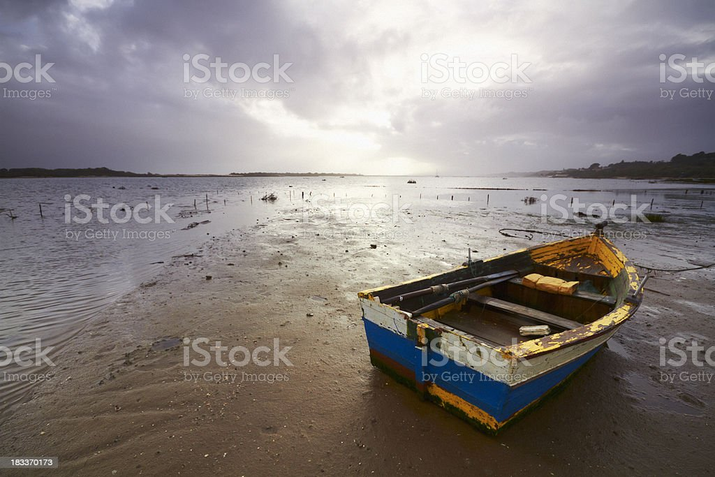 Small Fishing Boat at Low Tide stock photo