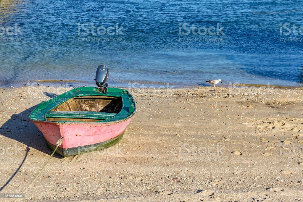 Small fishing boat beached stock photo