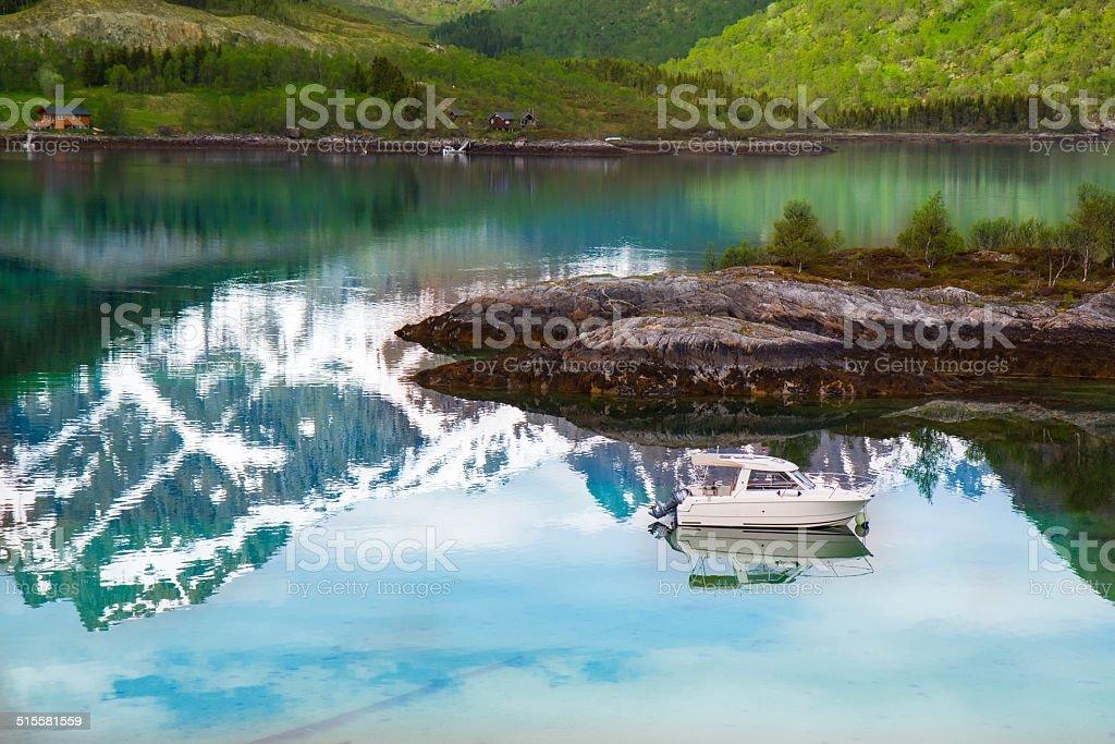Small fishing boat in scenic fjord on Lofoten, Norway stock photo