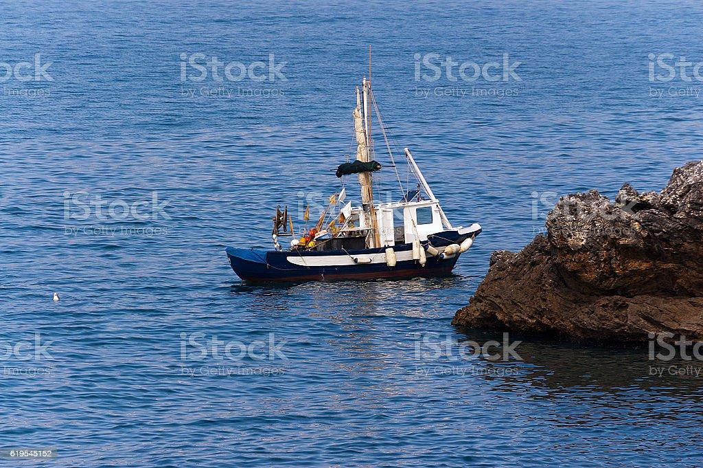 Small Fishing Boat in the Sea - Liguria Italy stock photo