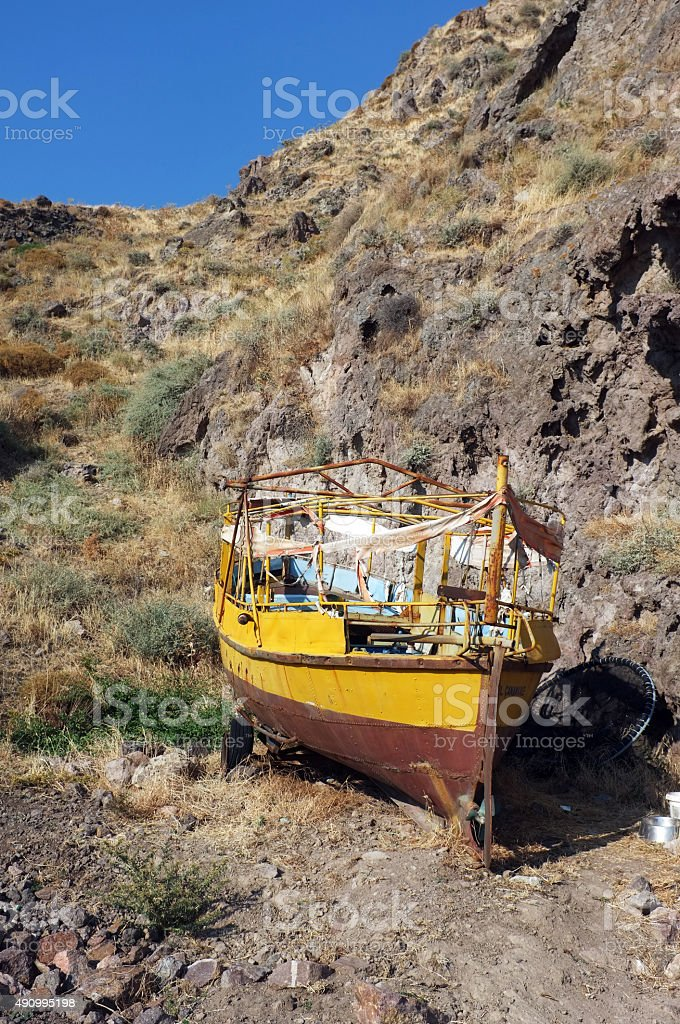 Small fishing boat on dry land stock photo