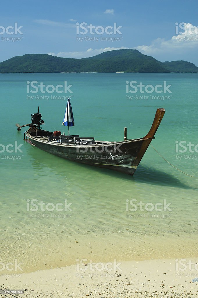 Small fishing boat on the beach royalty-free stock photo
