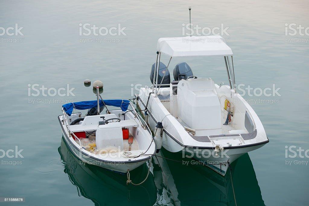 Small fishing  boats anchored stock photo