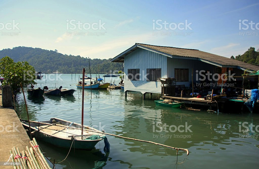 Small fishing boats anchoring in Thai floating village stock photo