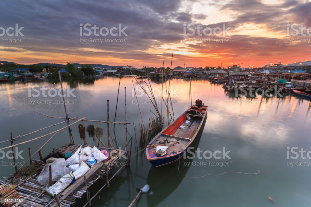 small fishing boats at fisherman village with sunset stock photo