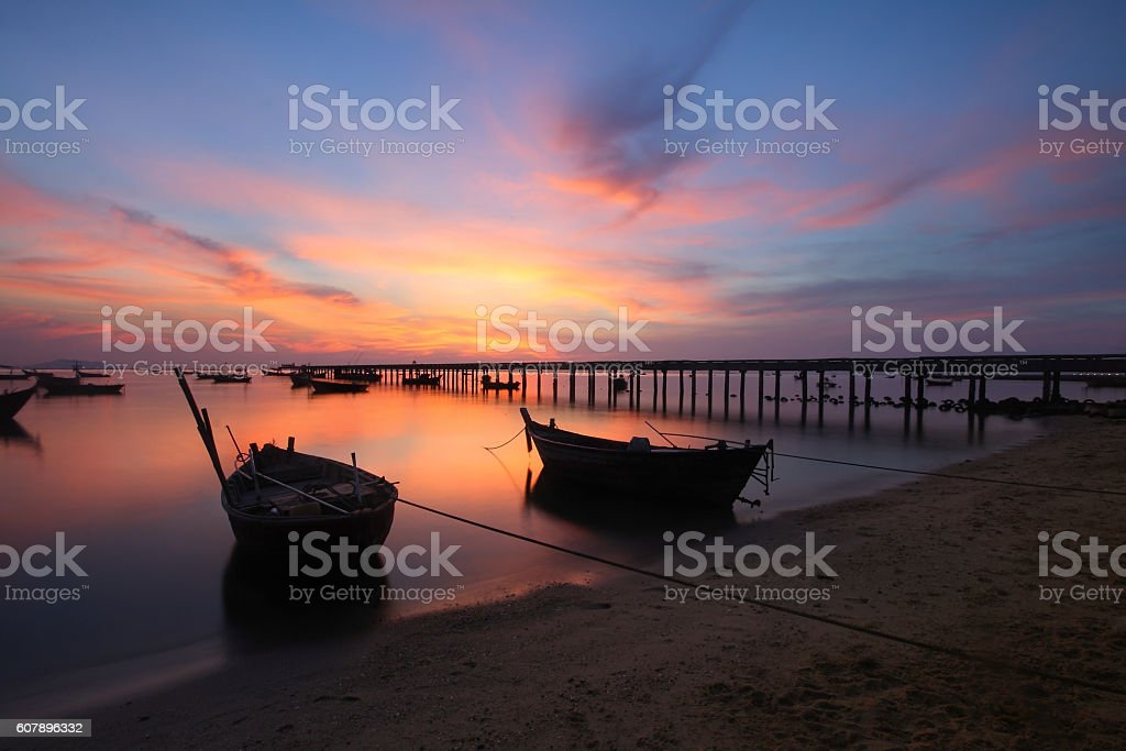 small fishing boats moored beached stock photo