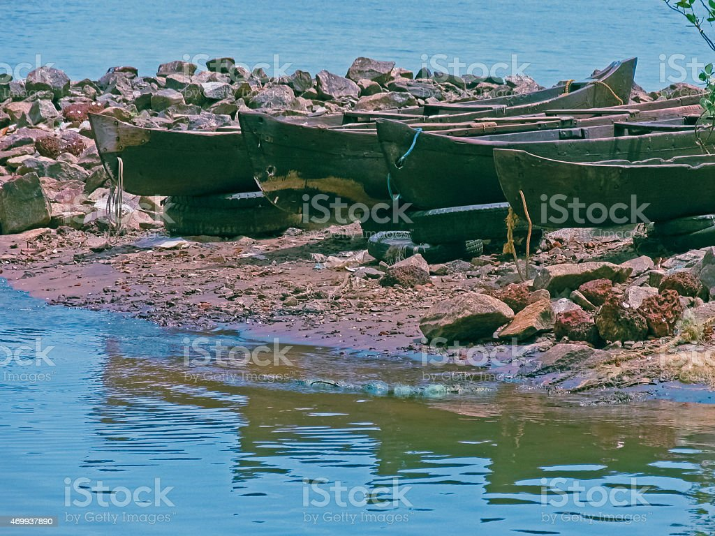 Small fishing boats on a beach at Beypore stock photo