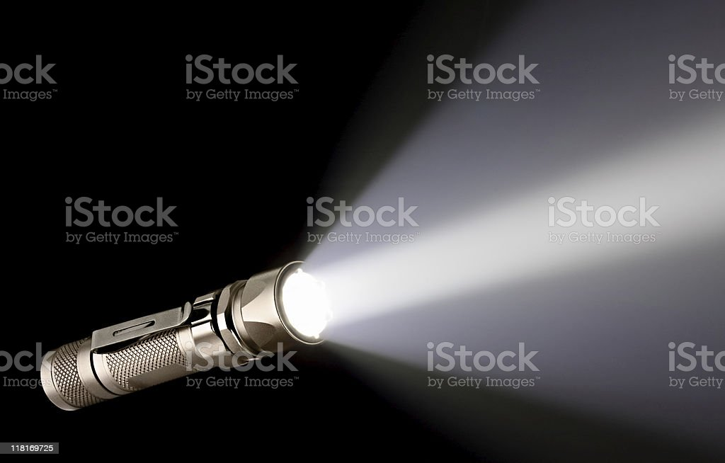 Small flashlight, isolated on black background, clipping path stock photo