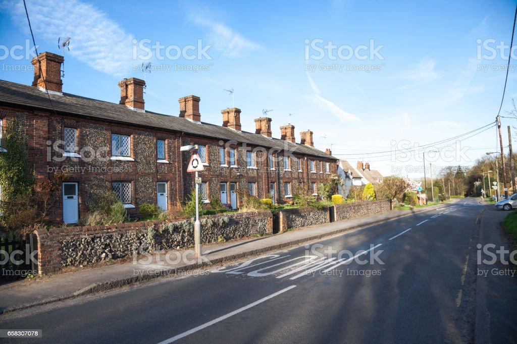 small flint and brick houses in Essex village England stock photo