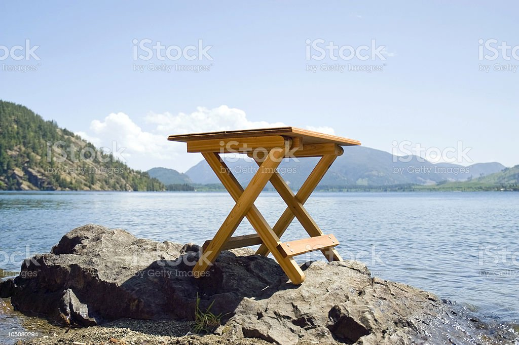 Small Fold-up Table Overlooking the Lake royalty-free stock photo