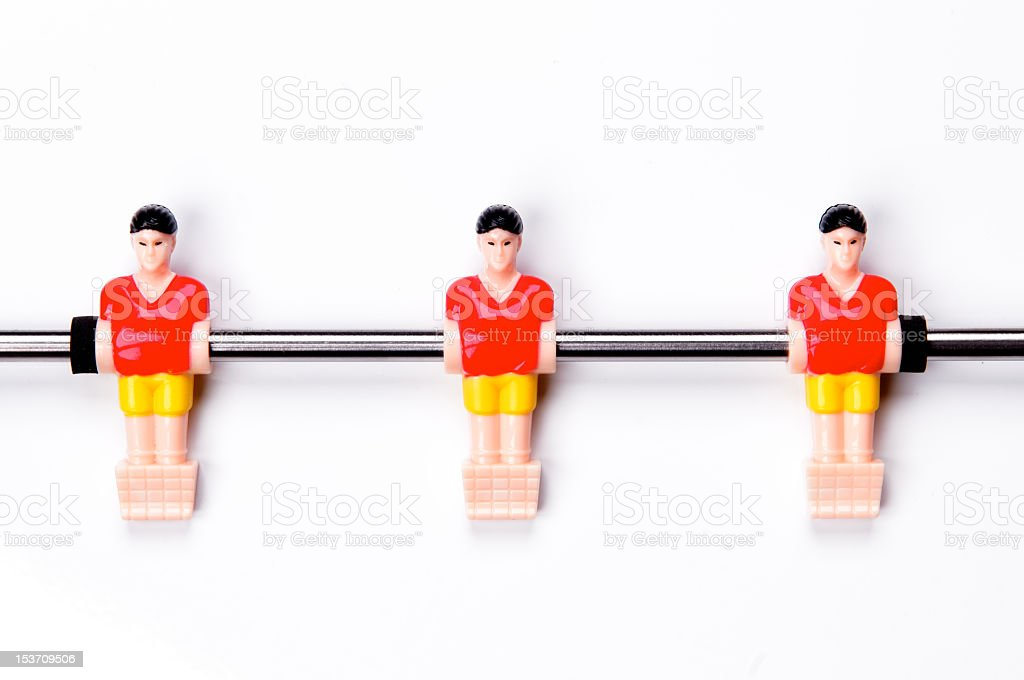 Small football players in a table football royalty-free stock photo