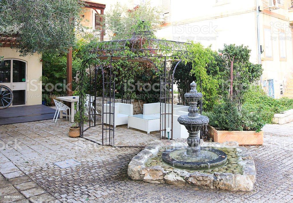 Small fountain and a gazebo in German colony in Haifa stock photo