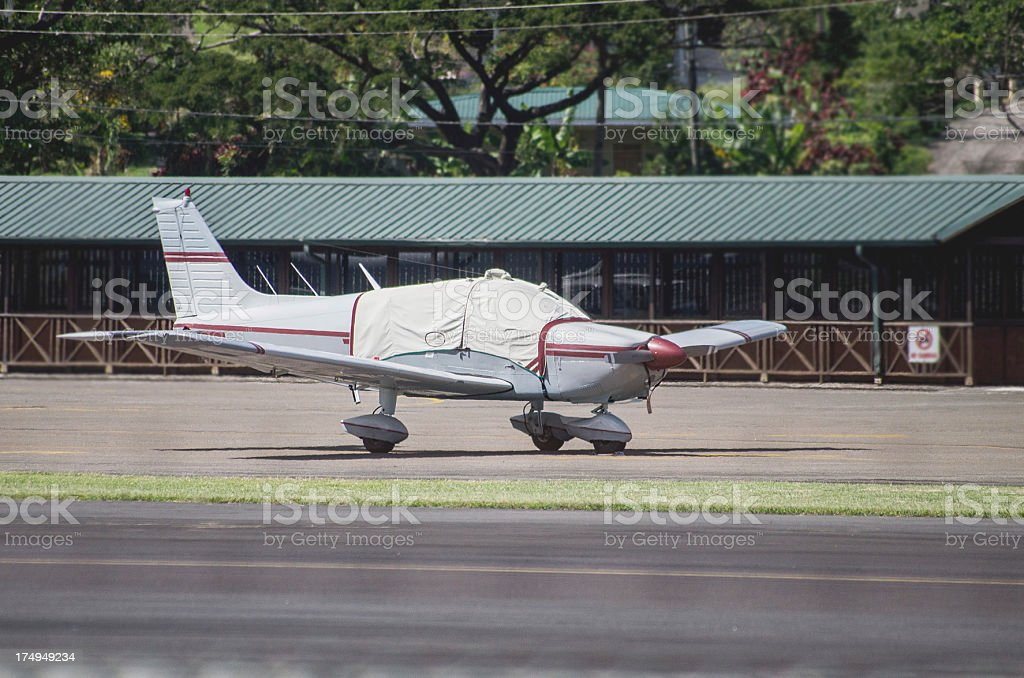small four seater aircraft with potective covering on airport royalty-free stock photo
