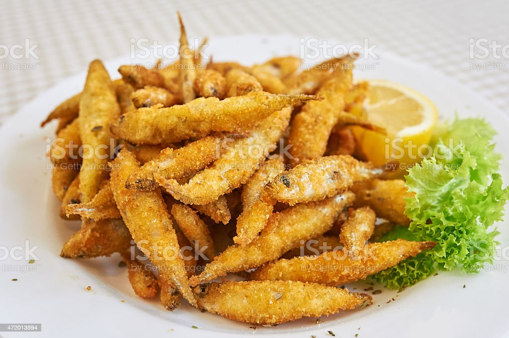 Small fried fish tapas in Spain. stock photo