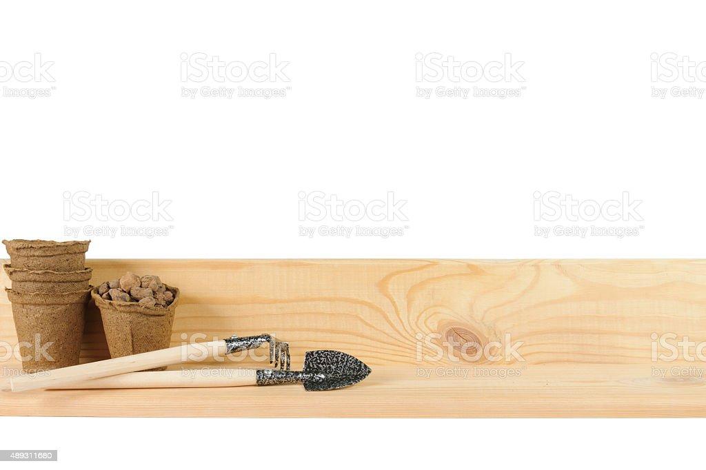 Small garden tools beside peat pots stock photo