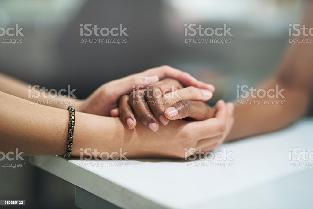 Small gestures that bridge the divide stock photo