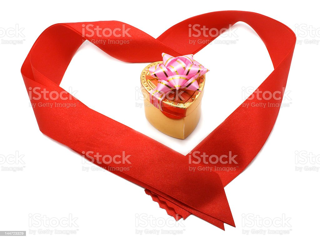 Small gift box in red heart-shaped ribbon isolated royalty-free stock photo