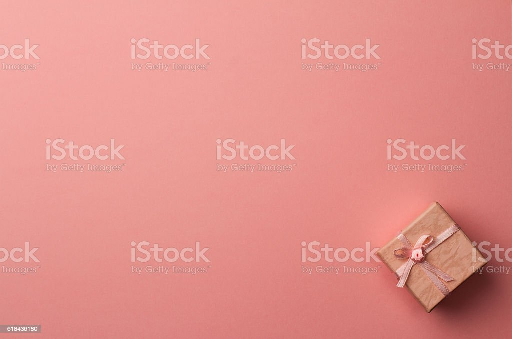 small gift box on pink paper background stock photo