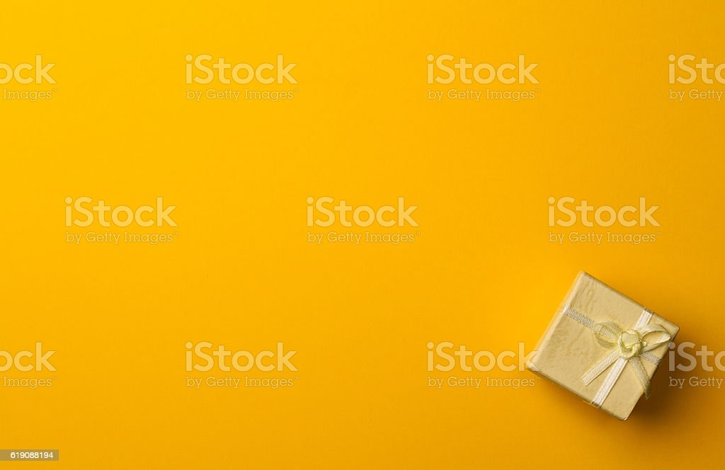 small gift box on yellow paper background stock photo