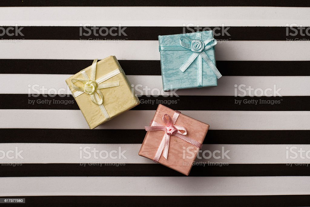 small gift boxes on stripes paper background stock photo