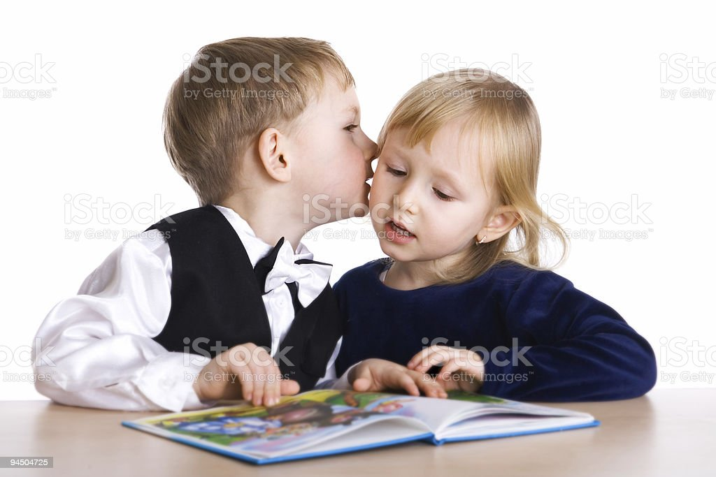 Small girl and boy read the book stock photo
