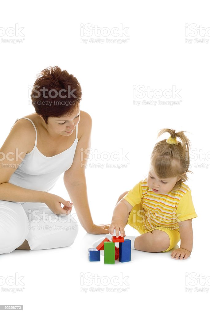 Small girl build pyramid with mother royalty-free stock photo