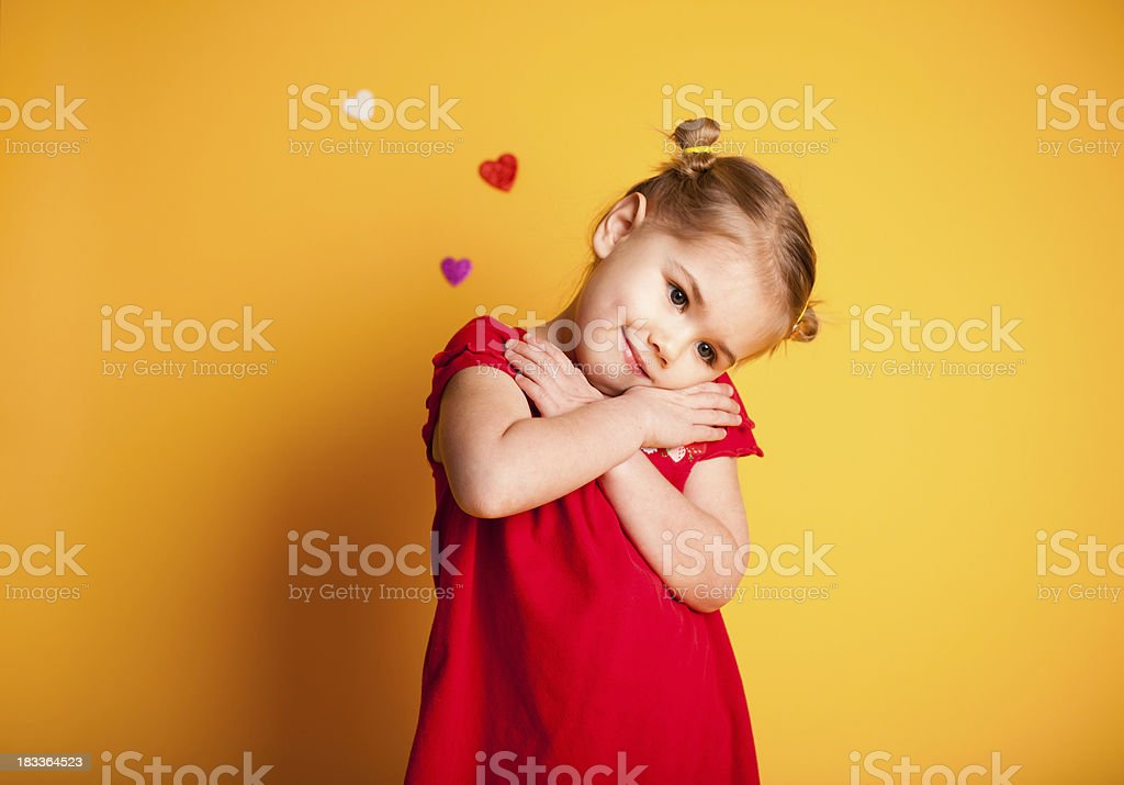 Small Girl Crossing Arms Showing Love stock photo