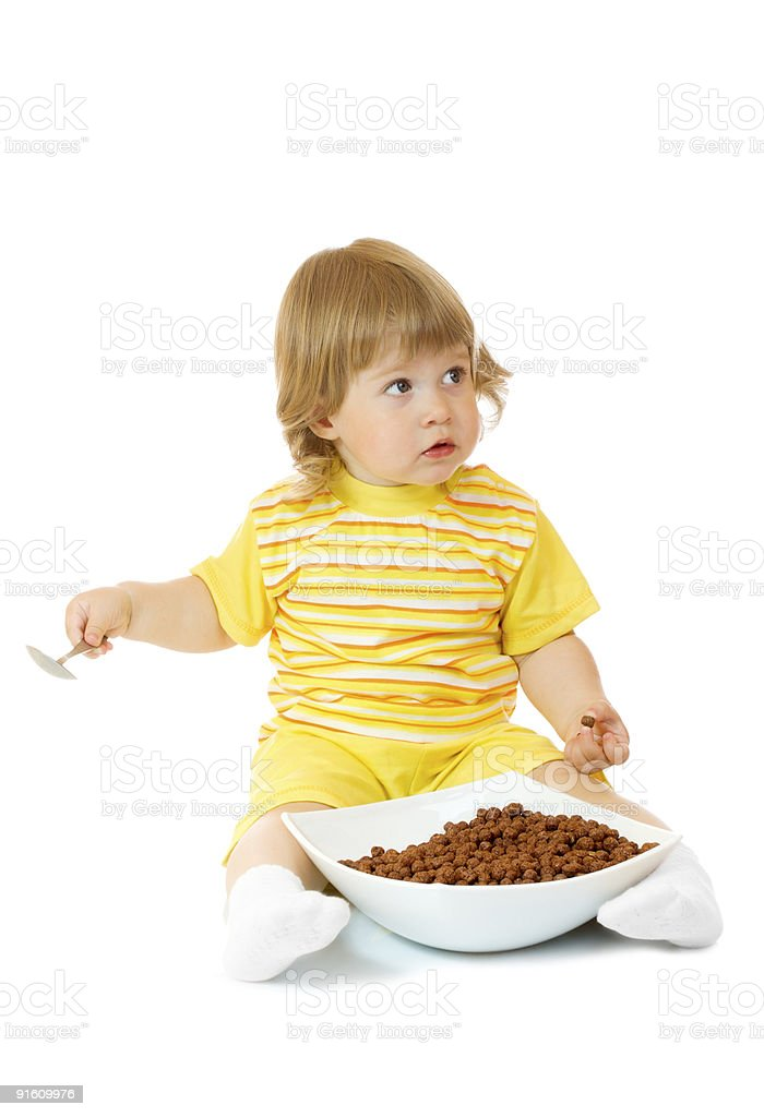 Small girl eat corn flakes royalty-free stock photo