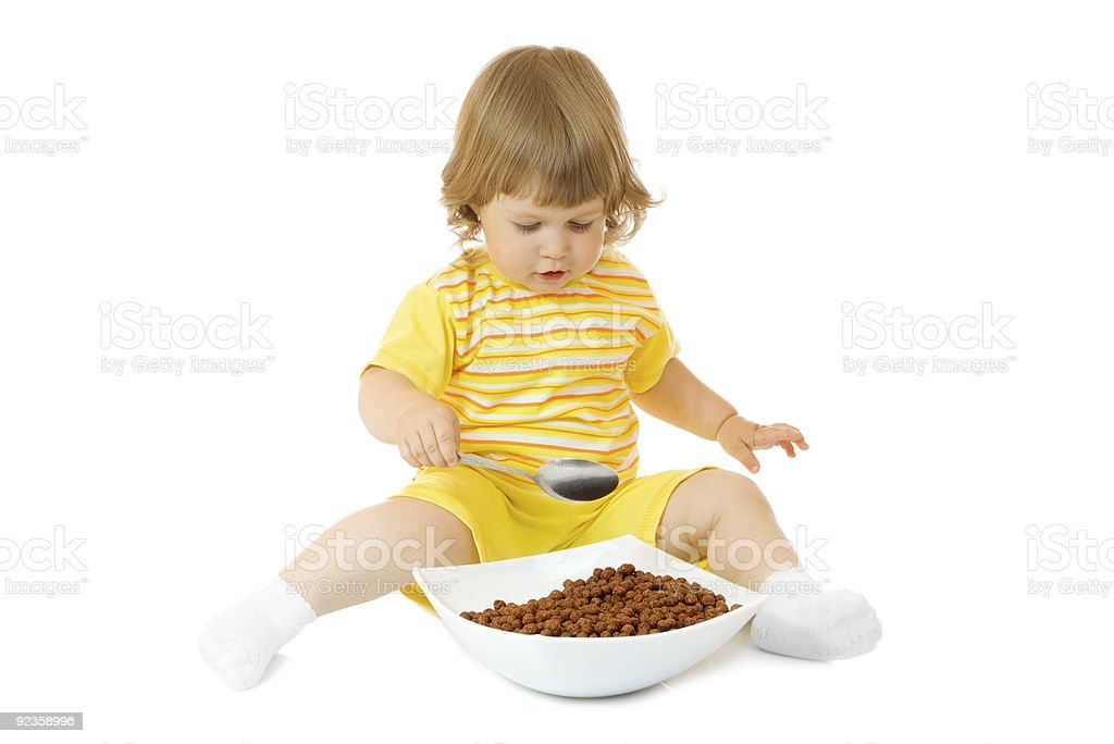 Small girl eat corn flakes royalty-free stock photo