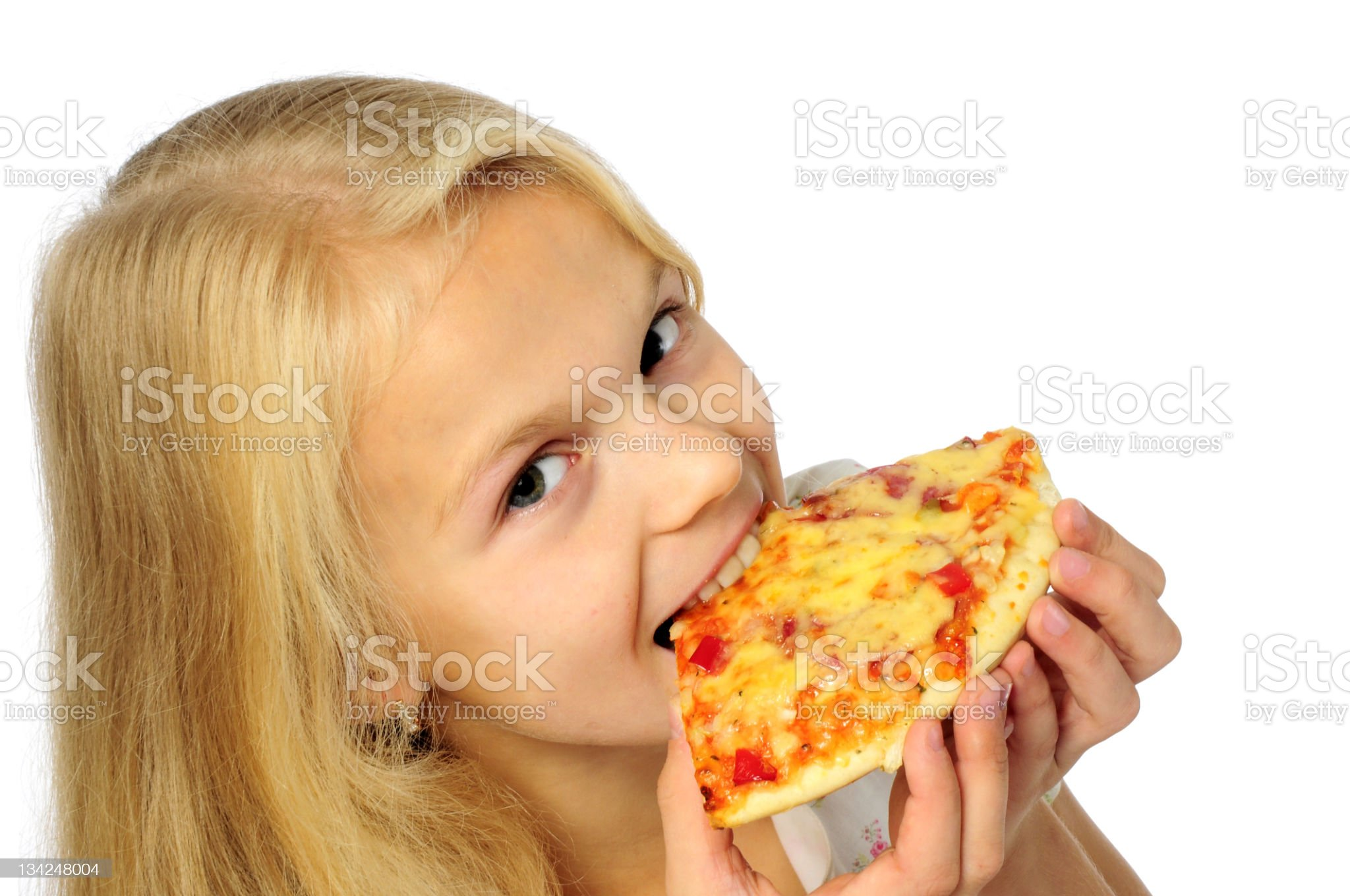 Small girl eating slice of pizza royalty-free stock photo