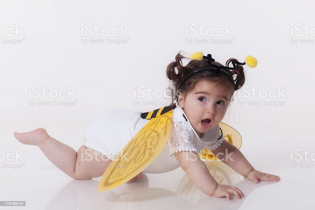 Small girl is dressed at bee costume stock photo