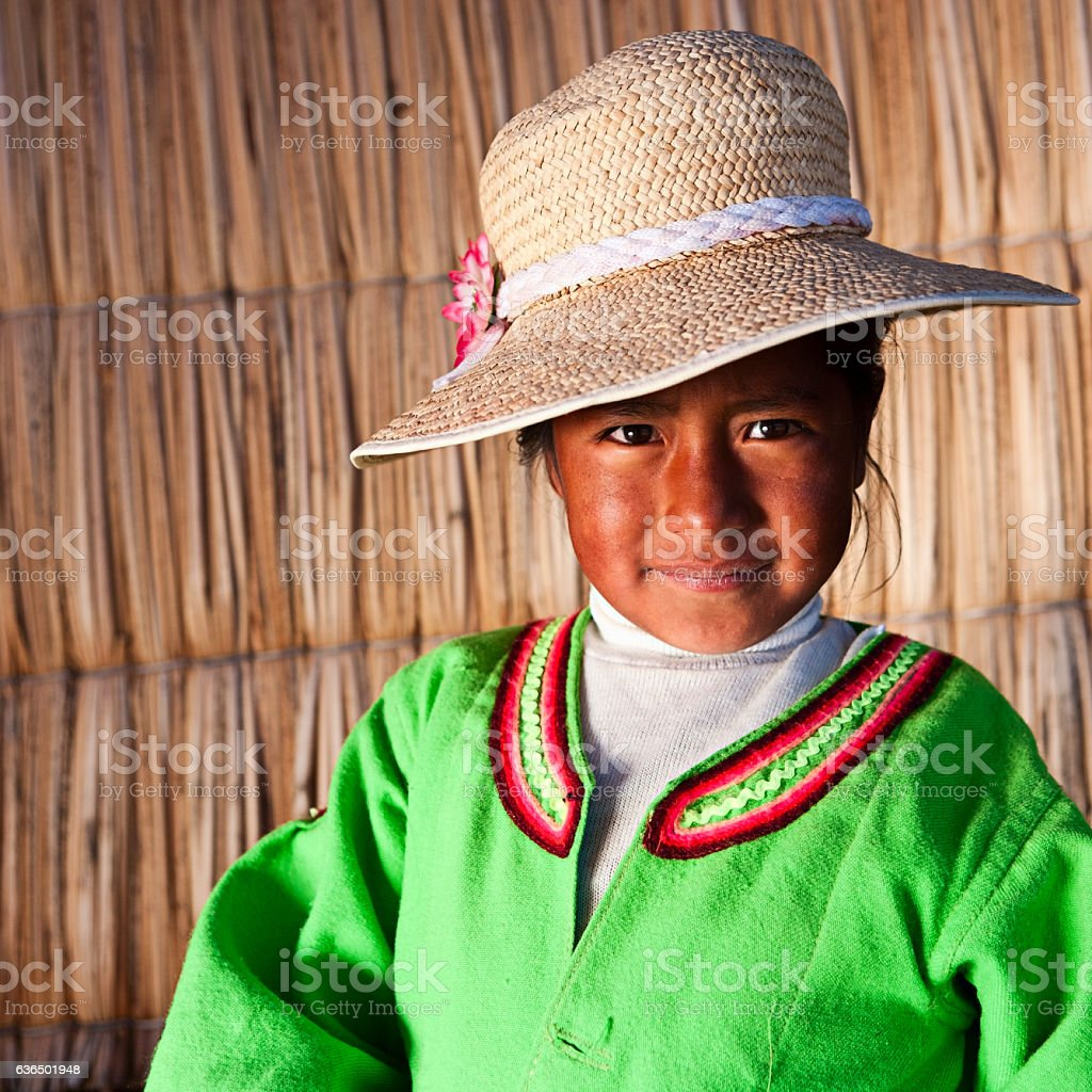 Small girl on Uros floating island stock photo