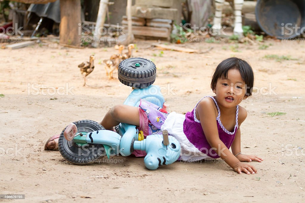 Small girl ride on  bicycle - crash - car accident stock photo
