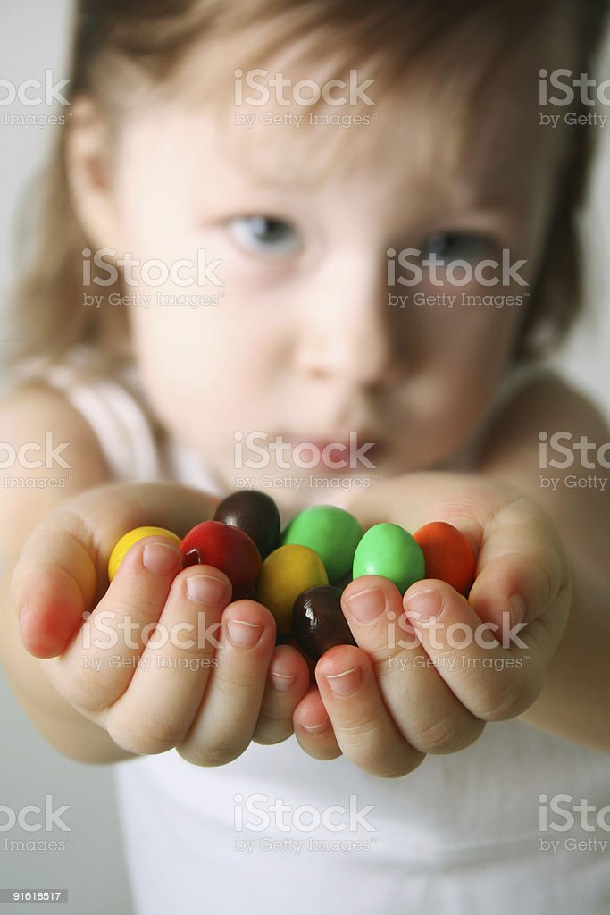 Small girl the hands candies royalty-free stock photo