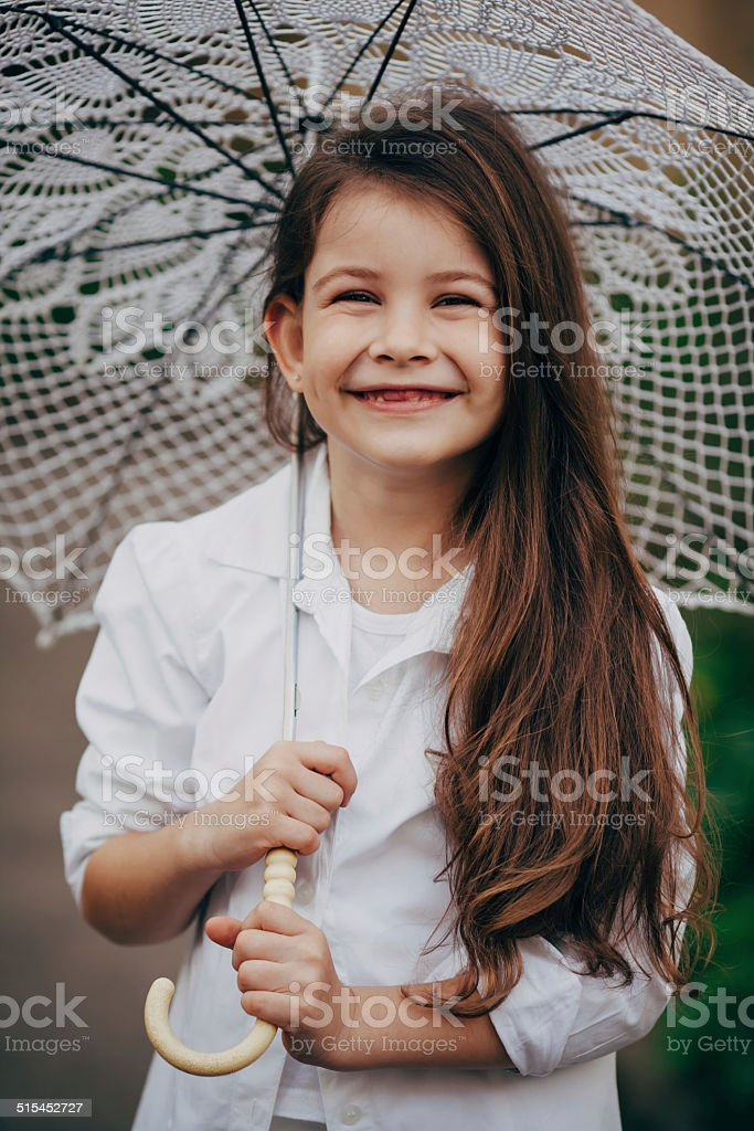 small girl with lace umbrella stock photo