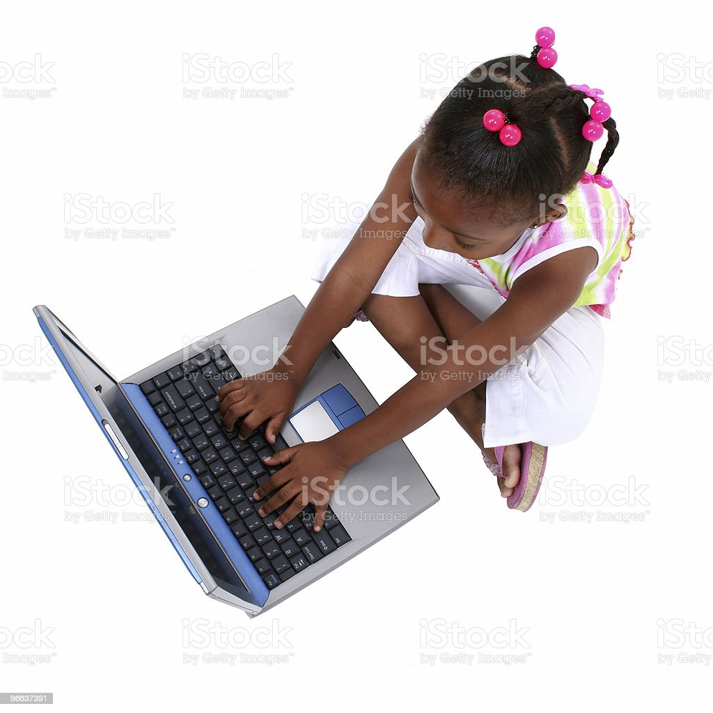 Small Girl Working On Laptop stock photo