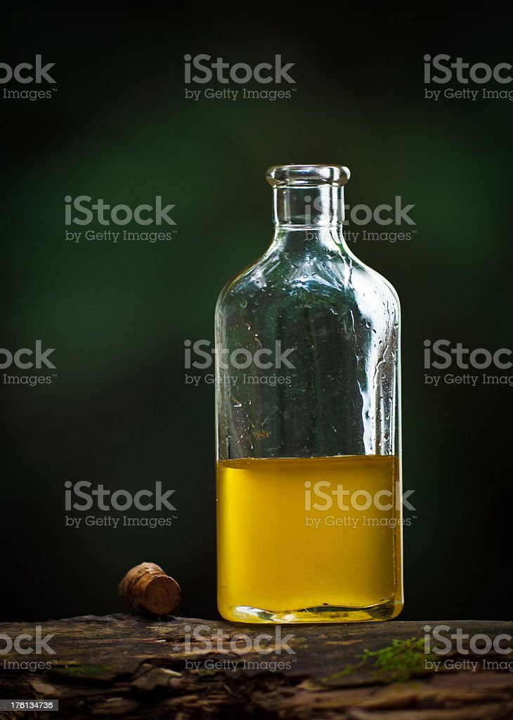 small glass bottle with a yellowish liquid stock photo