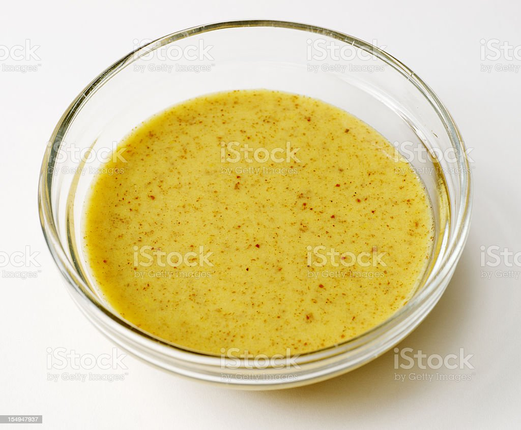 Small Glass Bowl Containing Mustard Vinaigrette Salad Dressing stock photo