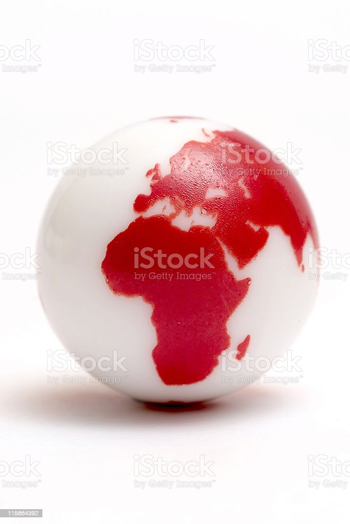 Small glass marble with globe design on white royalty-free stock photo