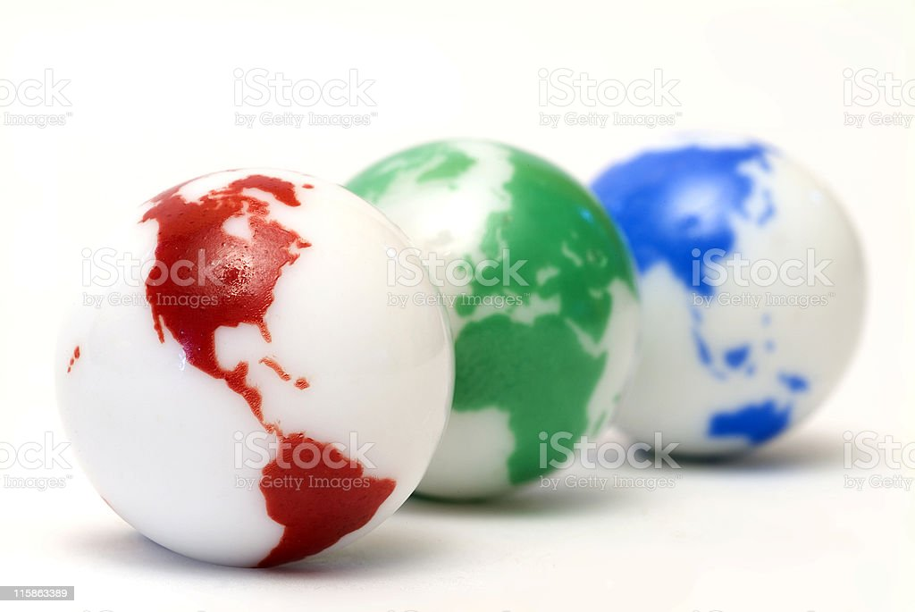 Small glass marbles with globe design on white royalty-free stock photo