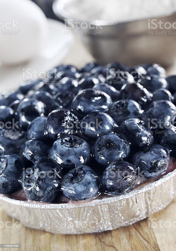 Small glazed blueberry pie stock photo