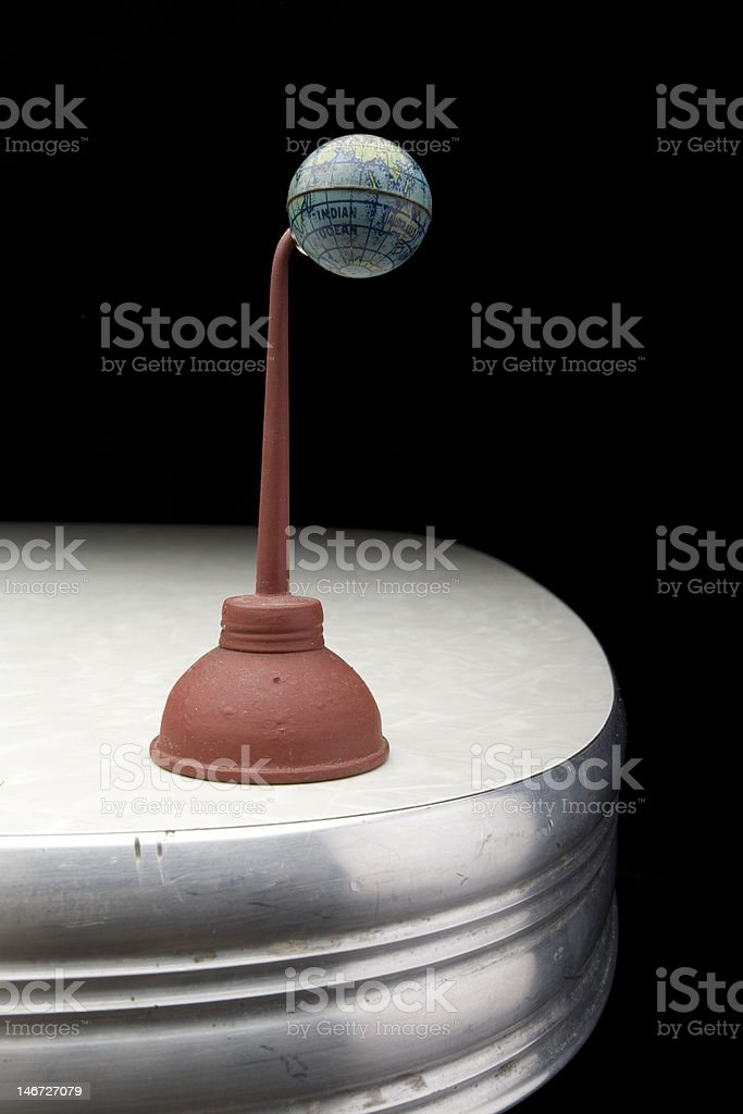 Small Globe on the End of a red Oil Can royalty-free stock photo