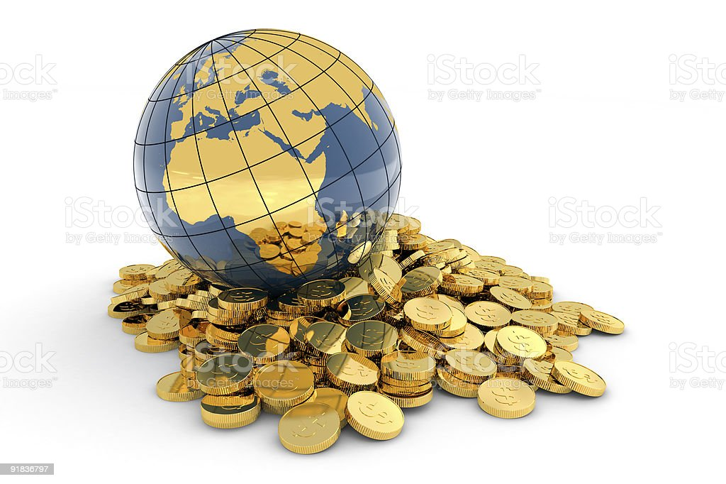 Small globe sitting on a pile of small gold coins stock photo