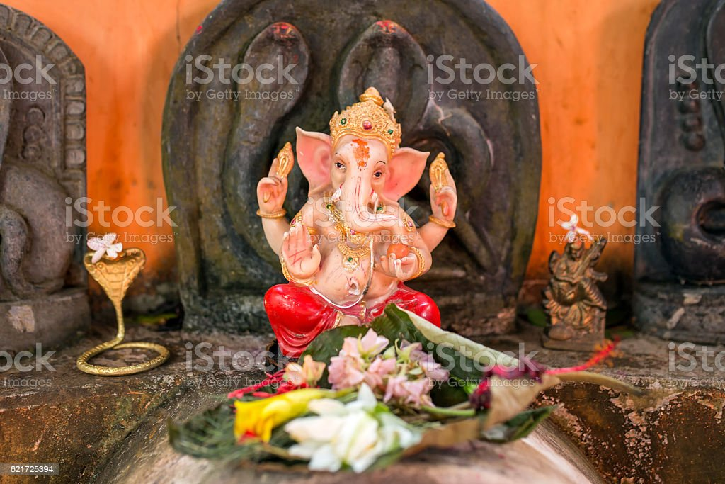 Small golden Ganesha with offers in India stock photo