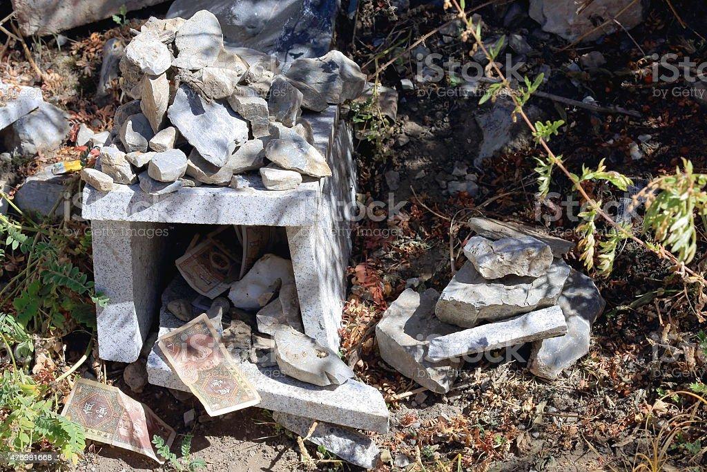 Small granite altar full of stones-money offerings. Drak Yerpa-Tibet. 1495 stock photo