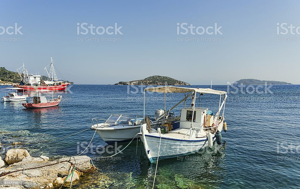 Small greek fishing boats moored. stock photo