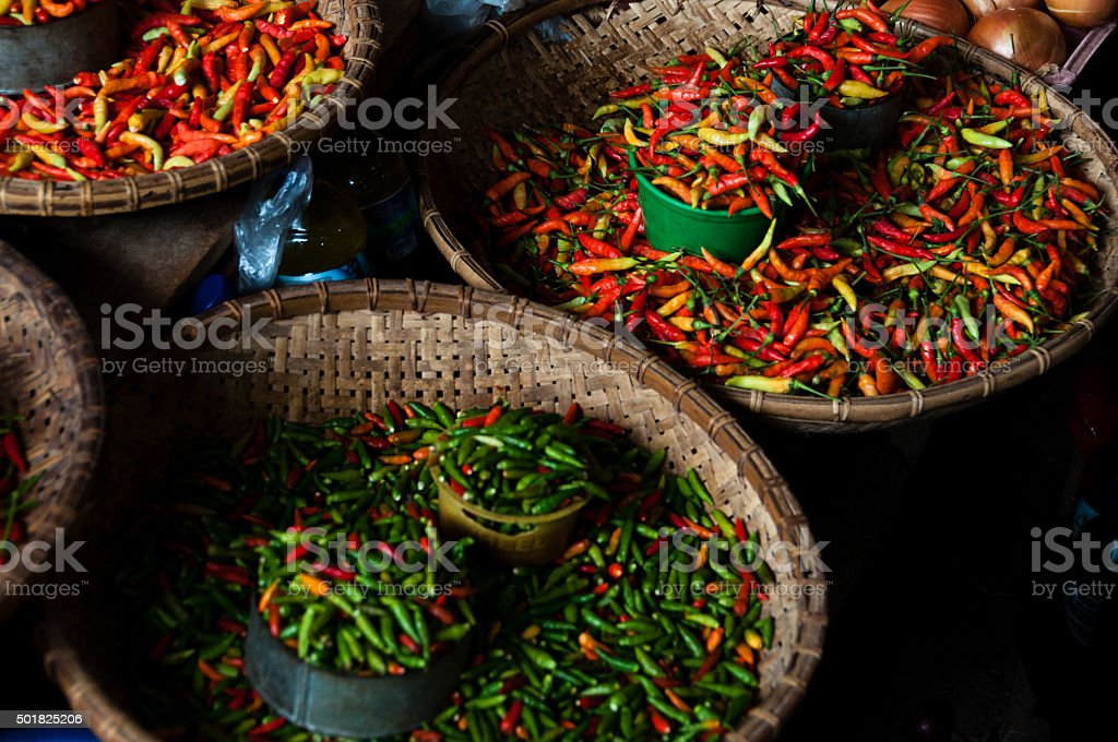 Small Green and Red Chillies at a local Market stock photo